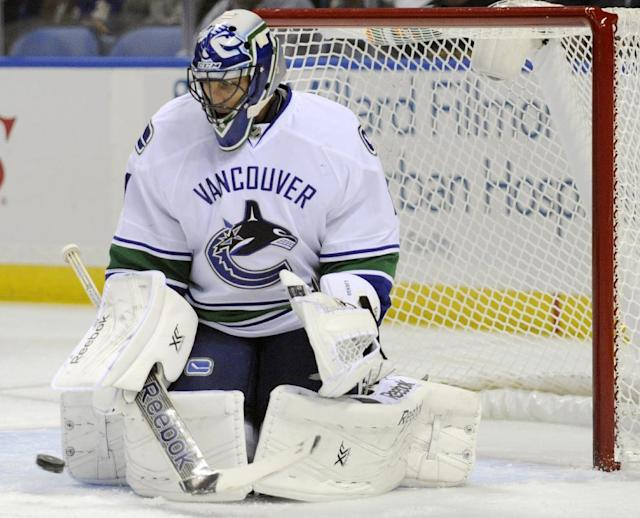 Vancouver Canucks goaltender Roberto Luongo makes a pad save during the first period of an NHL hockey game against the Buffalo Sabres in Buffalo, N.Y., Thursday, Oct. 17, 2013. (AP Photo/Gary Wiepert)