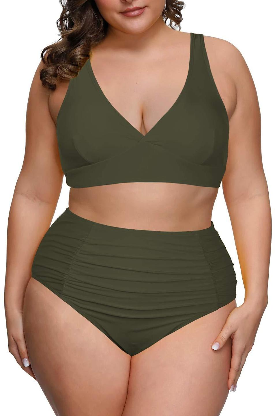 """<h2>Pink Queen High Waisted Ruched Tummy Control Bikini</h2><br>You can't go wrong with a monochromatic high-waisted bikini — especially when the color of choice is this earthy (and universally flattering) olive green. <br><br><strong>Hype:</strong> 4.2 out of 5 stars and 110 reviews<br><br><strong>Reviewers Say:</strong> """"Holy moly! This bikini is dope! I am a size 14-16 and I am 220lbs, 5'10, and have a pretty long torso and the bottoms are high wasted for sure, covers my belly button and then some. The orange is BRIGHT and I love it, it also has a slight shimmer type sheen to it and it is so much nicer than any other bikini I have ever seen or owned. The top fits well but my 38 Ds are ample and it supports. I didn't have any spilling-out issues. This bikini makes me feel like Beyoncé!""""<br><br><em>Shop<strong><a href=""""https://www.amazon.com/Pink-Queen-Swimwear-Waisted-Swimsuits/dp/B0842GFBK2/ref=sxin_9_sbv_search_btf"""" rel=""""nofollow noopener"""" target=""""_blank"""" data-ylk=""""slk:Amazon"""" class=""""link rapid-noclick-resp""""> Amazon</a></strong></em><br><br><strong>Pink Queen</strong> High Waisted Ruched Tummy Control Bikini Set, $, available at <a href=""""https://www.amazon.com/Pink-Queen-Swimwear-Waisted-Swimsuits/dp/B0842GFBK2/ref=sxin_9_sbv_search_btf"""" rel=""""nofollow noopener"""" target=""""_blank"""" data-ylk=""""slk:Amazon"""" class=""""link rapid-noclick-resp"""">Amazon</a>"""
