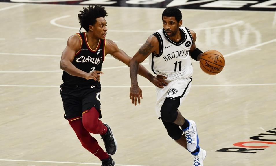 Kyrie Irving dribbles past Collin Sexton