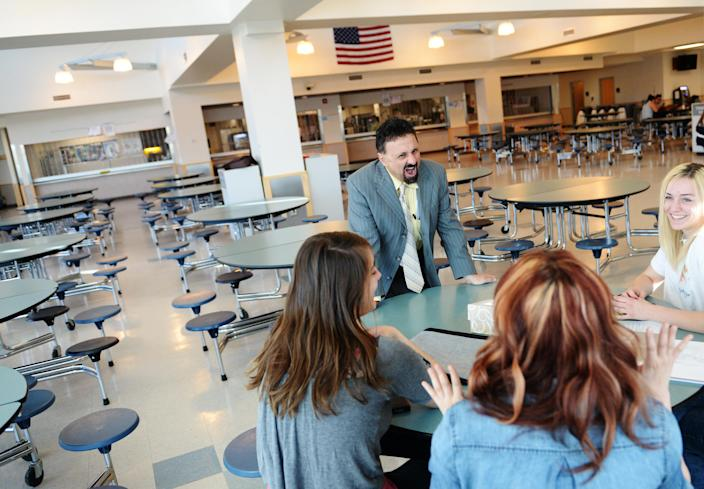 Former Columbine principal DeAngelis chats with students at the school in April 2014. (Photo: RJ Sangosti/The Denver Post via Getty Images)