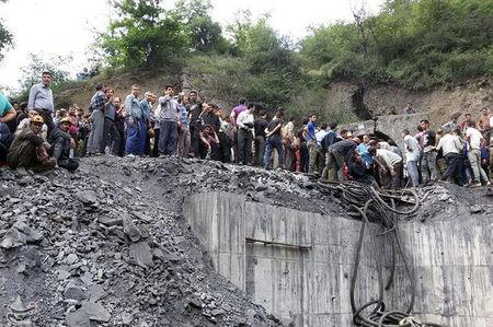People gather at the site of an explosion in a coal mine in Golestan Province