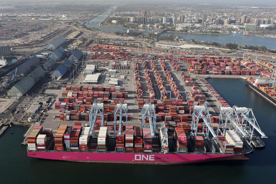 Shipping containers are unloaded from ships at a container terminal at the Port of Long Beach-Port of Los Angeles complex, amid the coronavirus disease (COVID-19) pandemic, in Los Angeles, California, United States , April 7, 2021. REUTERS / Lucy Nicholson