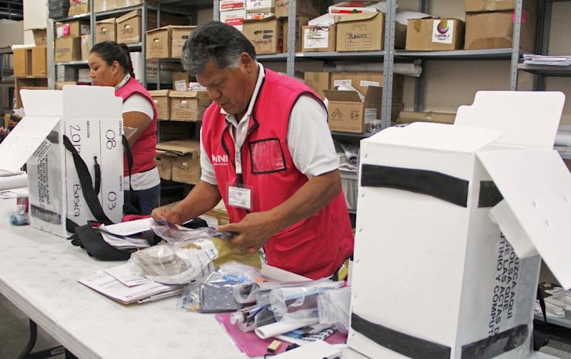 A Mexican National Electoral Institute worker checks electoral material in Ciudad Juarez Mexico