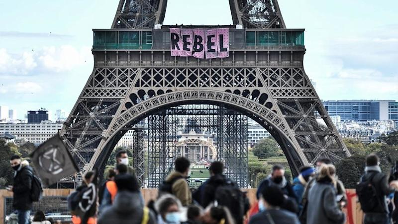 Extinction Rebellion activists scale Eiffel Tower to open week of climate action