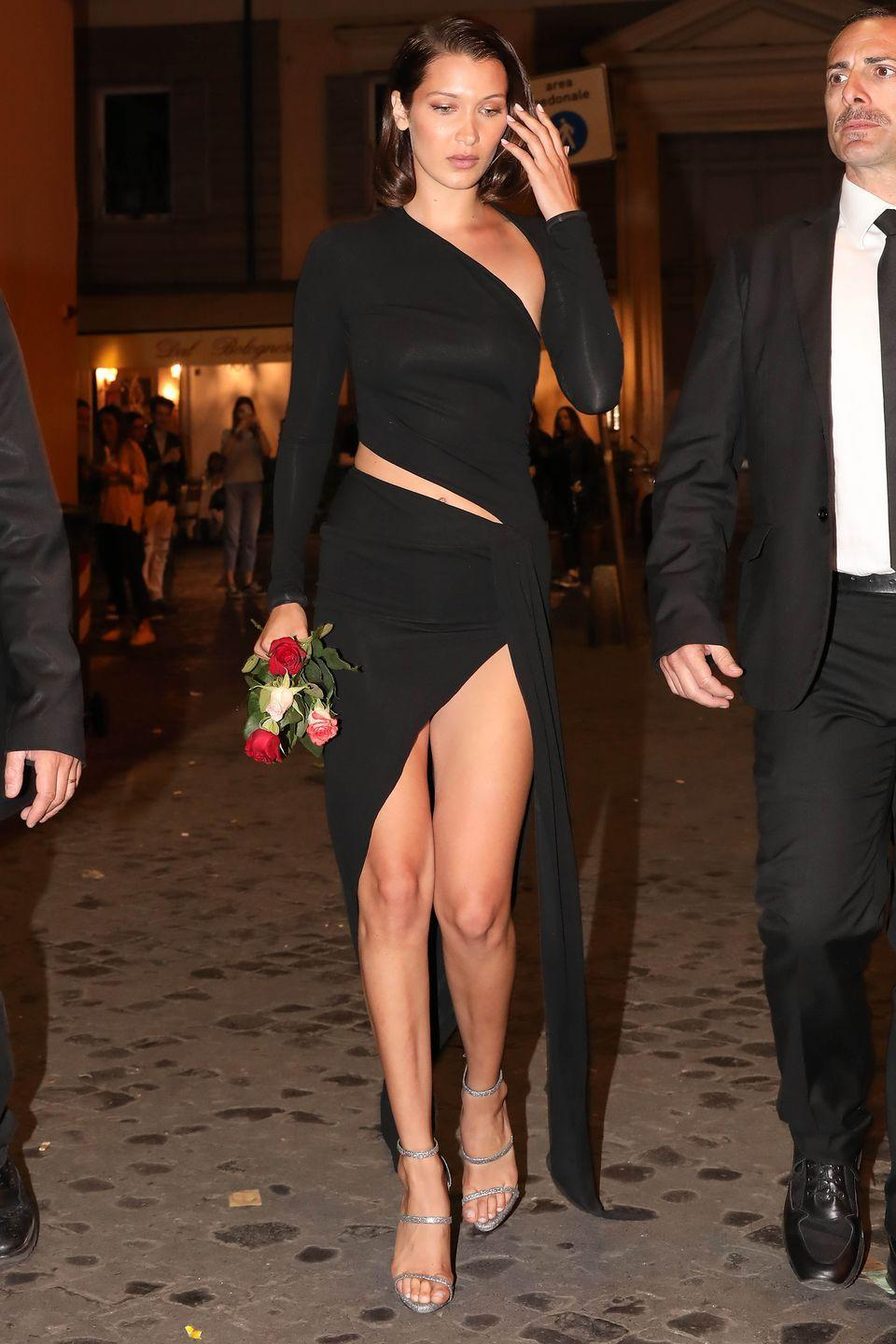 """<p>In an Alexandre Vauthier dress and Giuseppe Zanotti's """"HARMONY"""" Silver 3-Strap Sandal while out in Rome.</p>"""