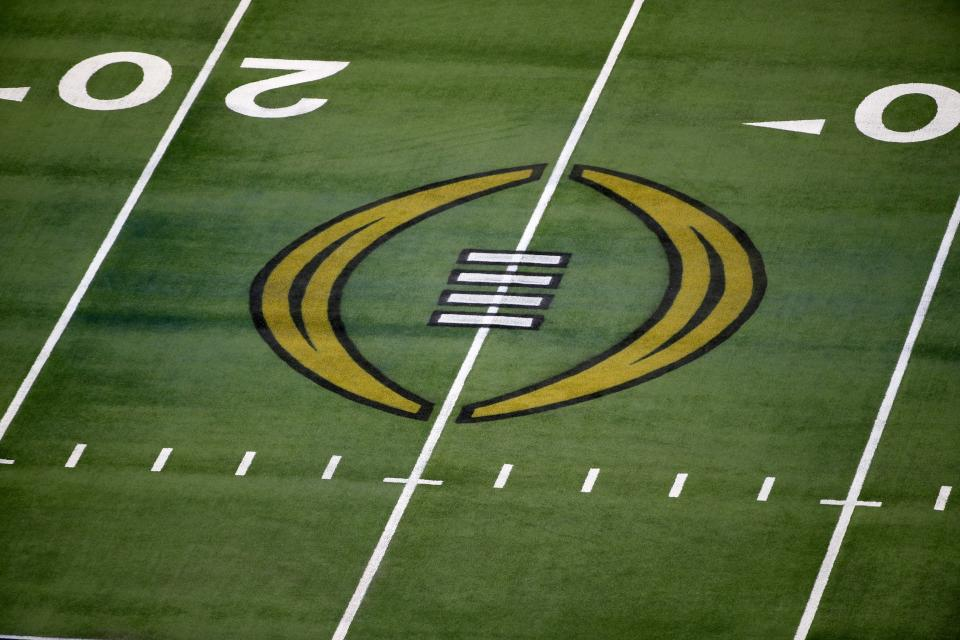 The College Football Playoff logo is shown on the field at AT&T Stadium before the Rose Bowl NCAA college football game between Notre Dame and Alabama in Arlington, Texas, Friday, Jan. 1, 2021. (AP Photo/Roger Steinman)