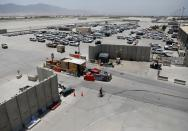 Parked vehicles are seen in Bagram U.S. air base, after American troops vacated it, in Parwan province