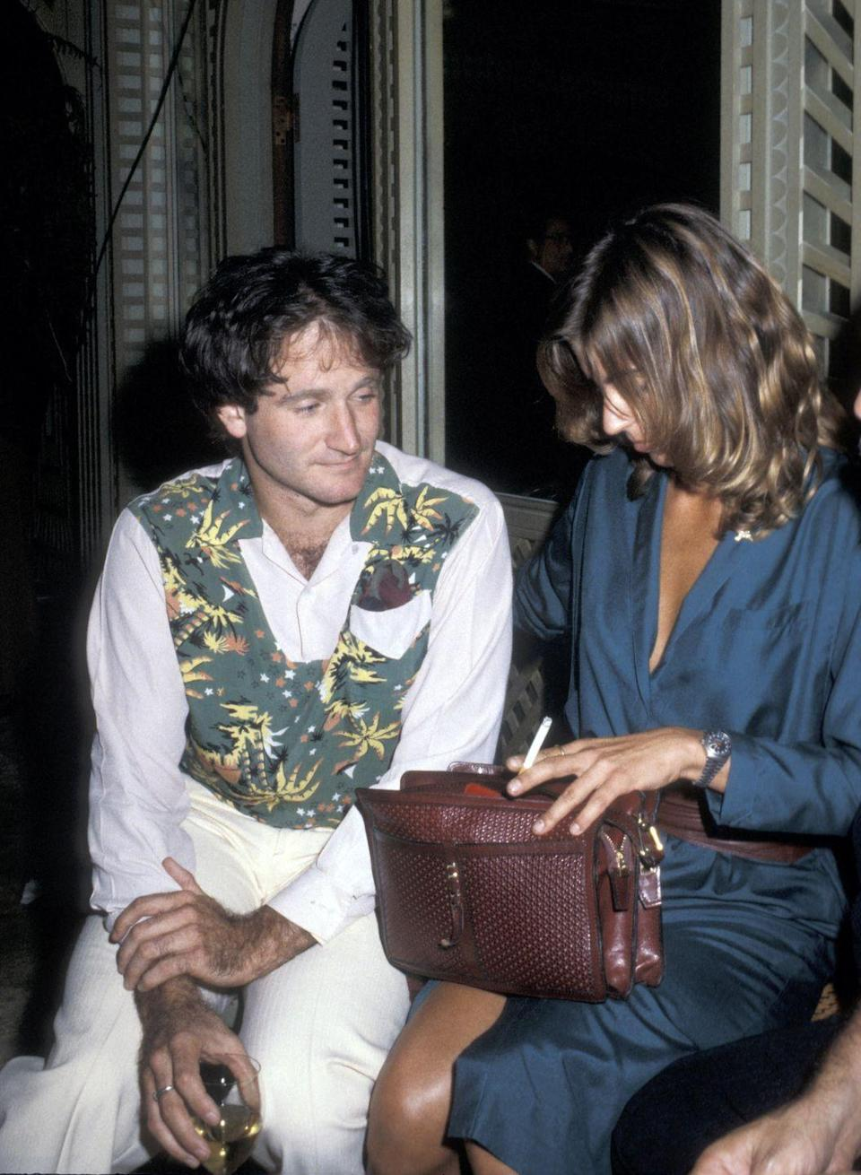<p>Woven leather purses followed suit after straw bags, as seen here on Valerie Velardi, Robin Williams' then-wife. </p>