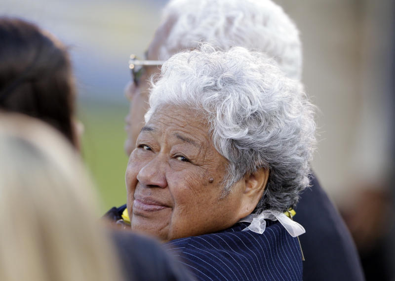 The mother of the late Junior Seau, Luisa Seau, looks back during a public memorial service for the football player at Qualcomm Stadium, Friday, May 11, 2012, in San Diego. Junior committed suicide on May 2 at his Oceanside, Calif., home. He played parts of 20 seasons in the NFL, with the SanDiego Chargers, Miami Dolphins and New England Patriots. (AP Photo/ Gregory Bull)