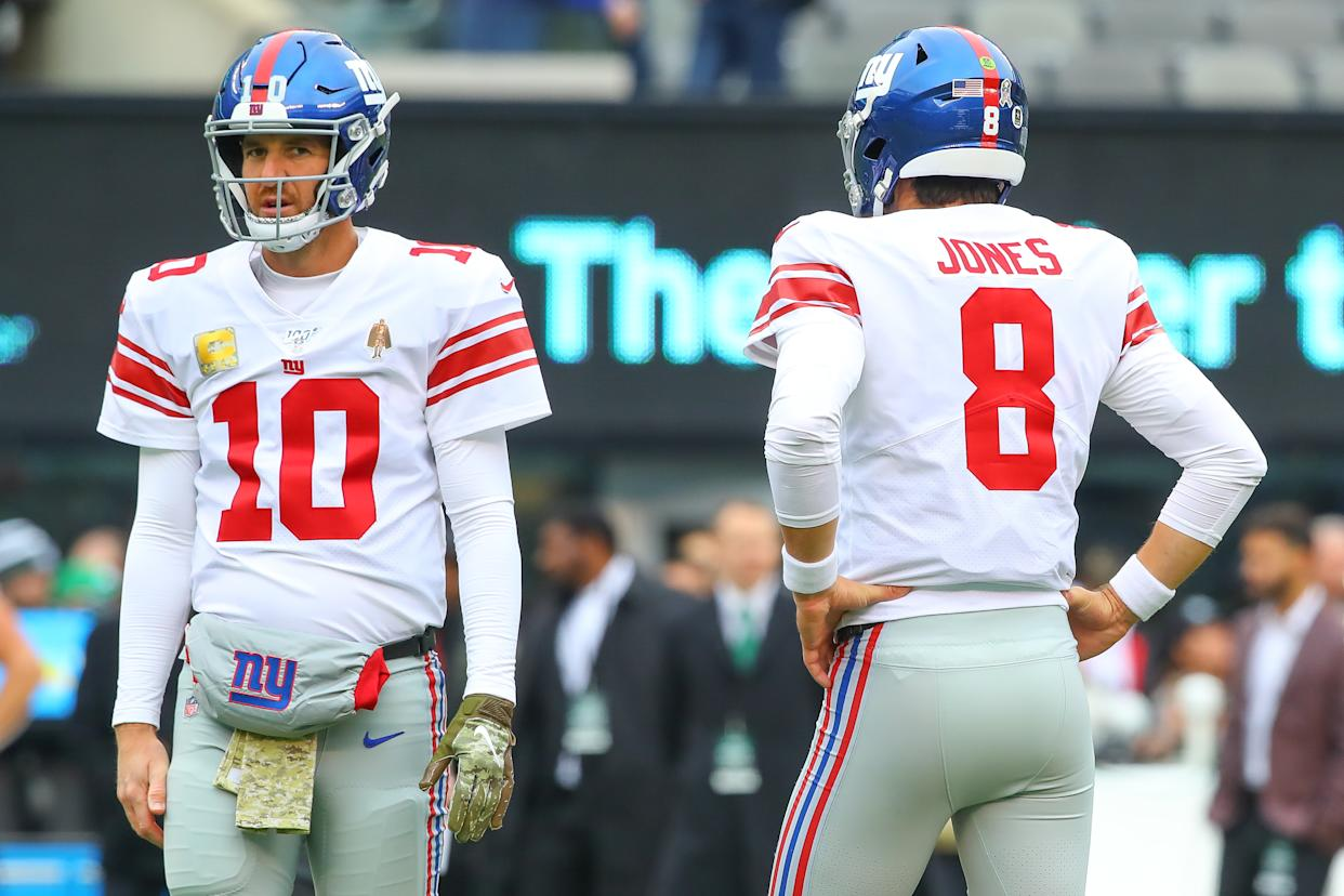 Eli's back: Daniel Jones, right, has a sprained ankle so Eli Manning, left, will likely start for the New York Giants on Monday. (Rich Graessle/Icon Sportswire via Getty Images)