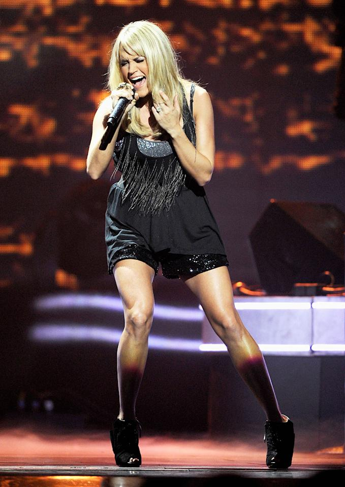 """Little did Carrie Underwood know when she auditioned for """"American Idol"""" in 2004 at age 21 that her entire life was about to change forever. After winning the fourth season of the reality competition show the following year, the country-focused songstress went on to put out a string of hit albums and must now have a room in her house dedicated just to her awards, including multiple Grammys and the coveted Country Music Association Entertainer of the Year honor, which she landed two years in a row. Ethan Miller/<a href=""""http://www.gettyimages.com/"""" target=""""new"""">GettyImages.com</a> - September 23, 2011"""