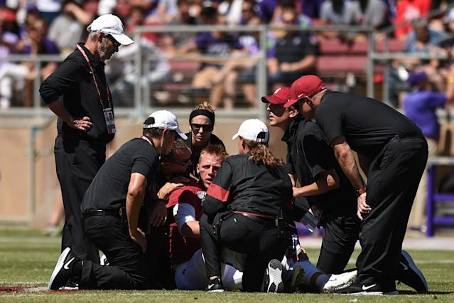 "Stanford quarterback <a class=""link rapid-noclick-resp"" href=""/ncaaf/players/267951/"" data-ylk=""slk:K.J. Costello"">K.J. Costello</a> (3) is attended to by medical staff after sustaining an injury against Northwestern. (Photo by Cody Glenn/Icon Sportswire via Getty Images)"