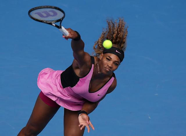 Serena Williams of the United States serves to Vesna Dolonc of Serbia during their second round match at the Australian Open tennis championship in Melbourne, Australia, Wednesday, Jan. 15, 2014.(AP Photo/Aaron Favila)