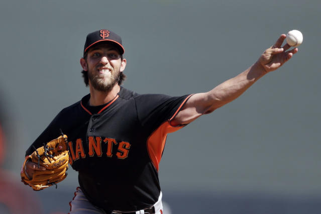 San Francisco Giants starting pitcher Madison Bumgarner pitches to a Colorado Rockies batter during the first inning of an exhibition spring training baseball game Tuesday, March 4, 2014, in Scottsdale, Ariz. (AP Photo/Gregory Bull)
