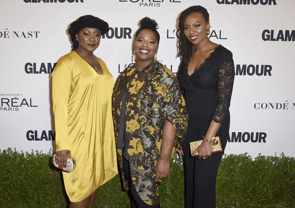 FILE - In this Nov. 14, 2016, file photo, Alicia Garza, from left, Patrisse Cullors and Opal Tometi, co-founders of the Black Lives Matter movement, arrive at the Glamour Women of the Year Awards at NeueHouse Hollywood in Los Angeles. Cullors, a co-founder of Black Lives Matter, announced Thursday, May 27, 2021, that she is stepping down as executive director of the Black Lives Matter Global Network Foundation. (Photo by Jordan Strauss/Invision/AP, File)