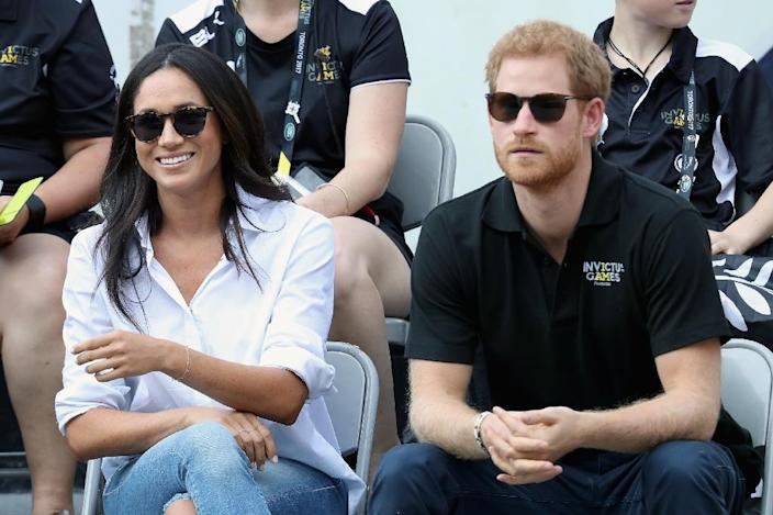 Watching a wheelchair tennis match some months before her wedding to Prince Harry, Meghan Markle's sartorial tastes still owed little to the duchess look which fits the royal family mould (AFP Photo/Chris Jackson)