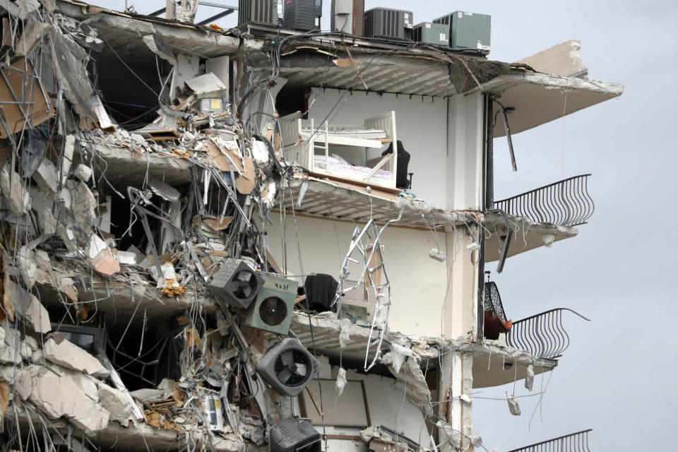 Items and debris dangle from a section of the oceanfront Champlain Towers South Condo that partially collapsed Thursday, June 24, 2021, in the Surfside area of Miami, Fla. (Susan Stocker/South Florida Sun-Sentinel via AP)