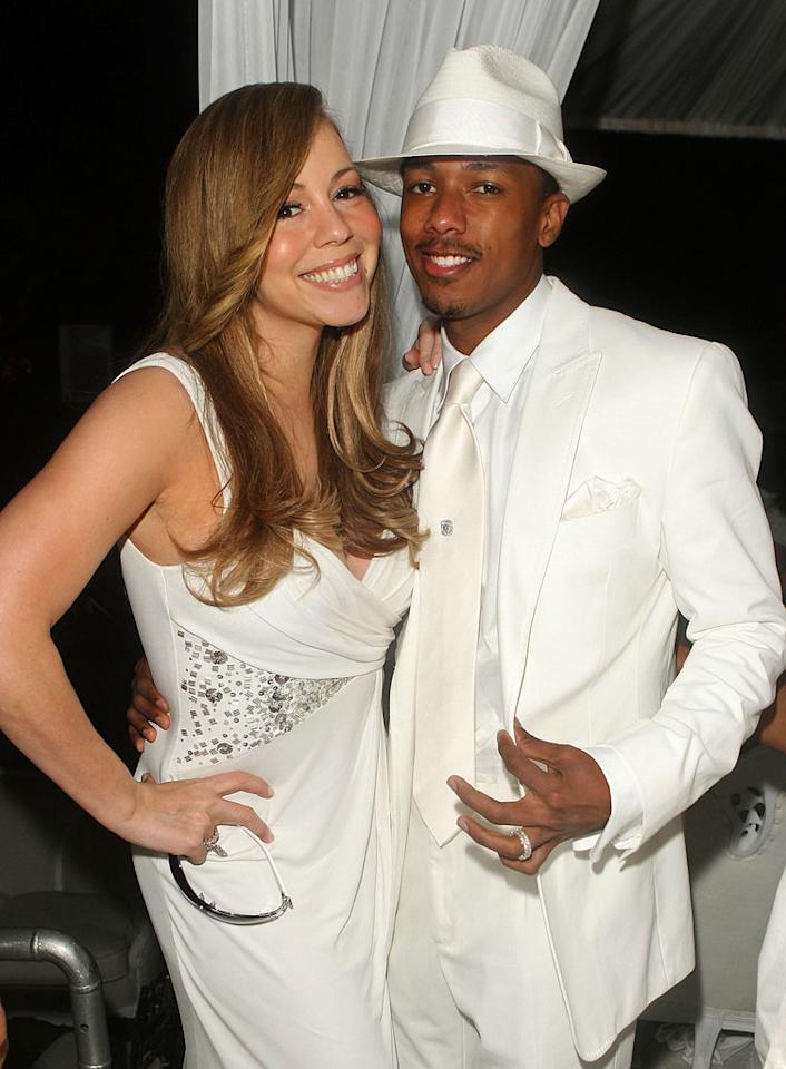 """Mariah Carey and hubby Nick Cannon flash their pearly whites for the paparazzi. Jason Merritt/<a href=""""http://www.gettyimages.com/"""" target=""""new"""">GettyImages.com</a> - July 4, 2009"""