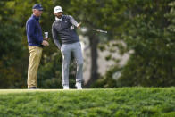 Dustin Johnson, right, discusses the 10th green during practice for the U.S. Open Championship golf tournament at Winged Foot Golf Club, Tuesday, Sept. 15, 2020, in Mamaroneck, N.Y. (AP Photo/John Minchillo)