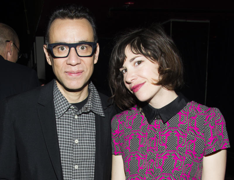 """FILE - This April 11, 2013 file photo originally released by IFC shows Fred Armisen, left, and Carrie Brownstein of the series """"Portlandia,"""" at IFC's 2013-14 Upfront Unexpectaganza in New York. The cable channel IFC said Wednesday it's picking up the show for two more seasons. They will premiere early next year and in 2015. Brownstein says the show will continue on the longer-narrative path, with more exploration of the dark side. (AP Photo/IFC, Charles Sykes, file)"""