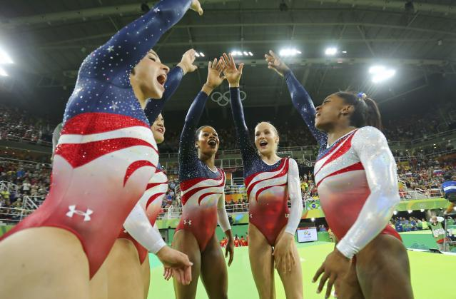 2016 Rio Olympics - Artistic Gymnastics - Final - Women's Team Final - Rio Olympic Arena - Rio de Janeiro, Brazil - 09/08/2016. (L-R) Alexandra Raisman (USA) of USA (Aly Raisman), Laurie Hernandez (USA) of USA, Gabrielle Douglas (USA) of USA (Gabby Douglas), Madison Kocian (USA) of USA and Simone Biles (USA) of USA celebrate winning gold in the women's team final. REUTERS/Mike Blake FOR EDITORIAL USE ONLY. NOT FOR SALE FOR MARKETING OR ADVERTISING CAMPAIGNS.