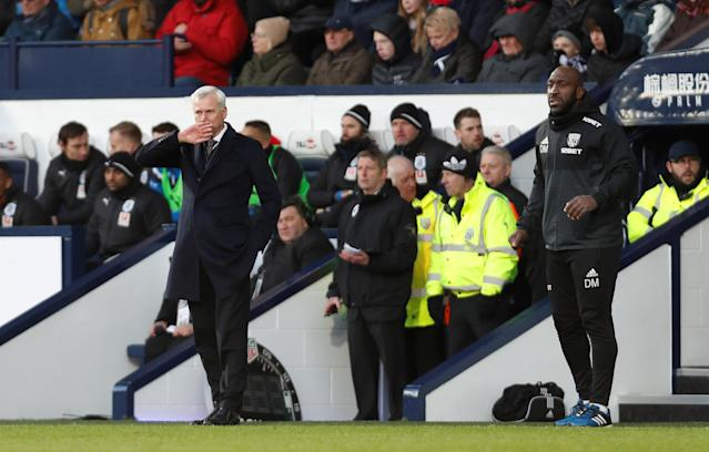 """Soccer Football - Premier League - West Bromwich Albion vs Huddersfield Town - The Hawthorns, West Bromwich, Britain - February 24, 2018 West Bromwich Albion manager Alan Pardew and first team coach Darren Moore Action Images via Reuters/Paul Childs EDITORIAL USE ONLY. No use with unauthorized audio, video, data, fixture lists, club/league logos or """"live"""" services. Online in-match use limited to 75 images, no video emulation. No use in betting, games or single club/league/player publications. Please contact your account representative for further details."""