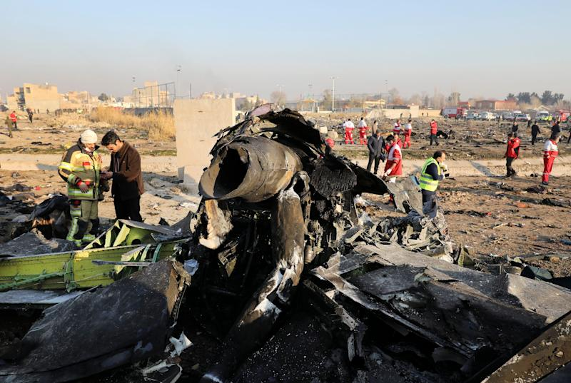 FILE - In this Wednesday, Jan. 8, 2020 file photo, debris at the scene where a Ukrainian plane crashed in Shahedshahr southwest of the capital Tehran, Iran. The crash of a Ukrainian jetliner near Tehran this week that killed all 176 on board comes as a test for Ukraine's President Volodymyr Zelenskiy, who took office less than eight months ago with no prior political experience. (AP Photo/Ebrahim Noroozi, File)