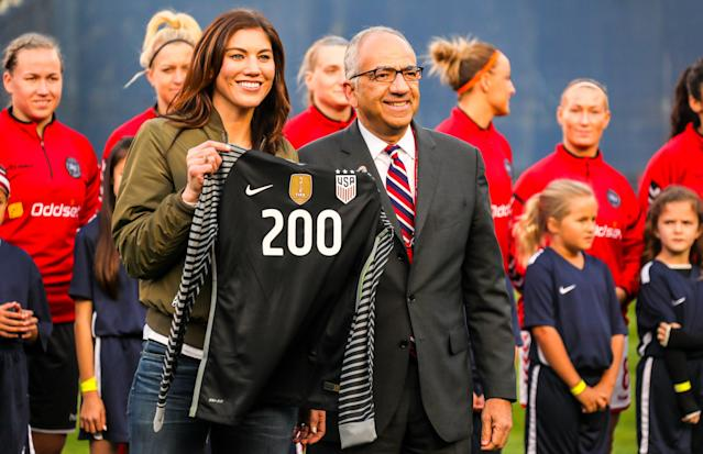 Carlos Cordeiro presented Hope Solo with a commemorative jersey last month. At Saturday's U.S. Soccer election, Solo blasted him. (Getty)