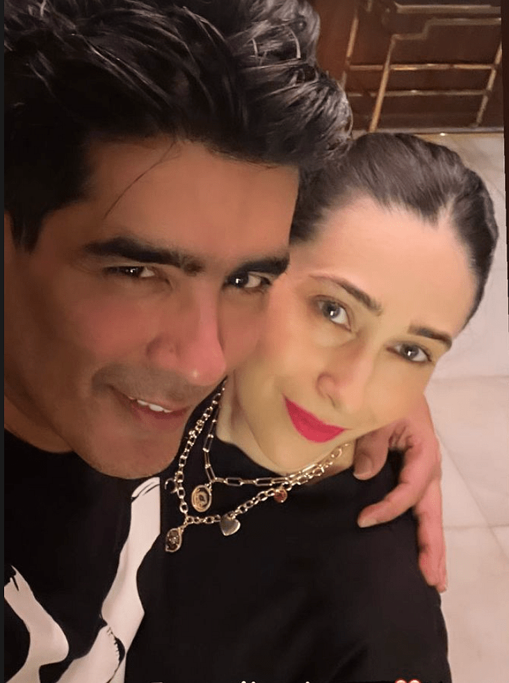"""<div class=""""paragraphs""""><p>Manish and Karisma at the party.</p></div>"""