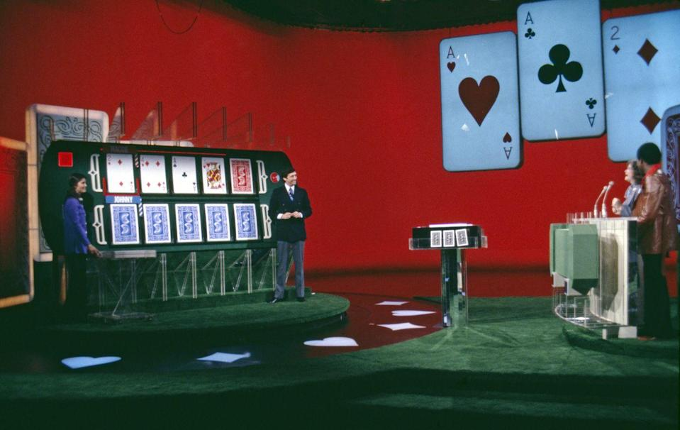 <p><em>Card Sharks </em>is based on a card game called Acey Deucey. It premiered in 1978 with Jim Perry as the original host. Perry, who also acted, was the host of game shows in the U.S. and Canada. <em>Card Sharks </em>continued to air through 2001.</p>