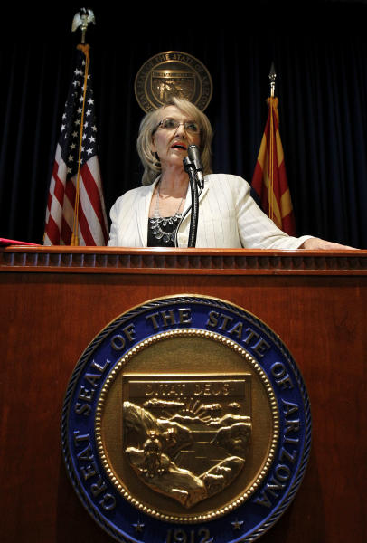 Arizona Gov. Jan Brewer answers a question during a brief news conference as she reacts to the United States Supreme Court decision regarding Arizona's controversial immigration law, SB1070, coming down at the Arizona Capitol Monday, June 25, 2012, in Phoenix. The Supreme Court struck down key provisions of Arizona's crackdown on immigrants Monday but said a much-debated portion on checking suspects' status could go forward Monday, June 25, 2012, in Phoenix.(AP Photo/Ross D. Franklin)
