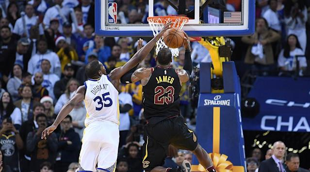 "<p>Twice LeBron James turned to the referees with legitimate grievances on Christmas, and twice he came up empty.</p><p>It's a bad sign when the most dramatic moments of the season's most highly-anticipated game to date find the NBA's two best players—James and Kevin Durant—bogged down in lengthy replay reviews and officiating controversies. There was no signature moment to the latest chapter between these two franchises, no chase down block or pull-up three to loop endlessly on highlight reels. Instead, there was James losing his balance and then losing possession—with help from Durant on both—as the Cavaliers lost their chance to spring a holiday upset.</p><p>With a little over a minute to go, James drove left on Durant, drawing contact across his body before losing the ball out of bounds without a whistle. With less than 30 seconds remaining, he drove right on Durant, who bumped his body and then appeared to come across his left shoulder to dislodge the ball without provoking a call. That pair of empty possessions helped Golden State close on a 7-0 run to seal a 99-92 win over Cleveland at Oracle Arena on Christmas.</p><p> ""He got me a little bit [on the first one]. I lost that one,"" <a href=""https://soundcloud.com/warriors/lebron-james-postgame-locker-room-122517"" rel=""nofollow noopener"" target=""_blank"" data-ylk=""slk:James said"" class=""link rapid-noclick-resp"">James said</a>. ""He fouled me twice [on the second one]. But whatever. What are you going to do about it?""</p><p>Durant, for his part, suggested that armchair referees stick to social media. ""Felt clean,"" <a href=""https://twitter.com/anthonyVslater/status/945430766808309760"" rel=""nofollow noopener"" target=""_blank"" data-ylk=""slk:he told reporters afterwards"" class=""link rapid-noclick-resp"">he told reporters afterwards</a>. ""If they didn't call it, it's not a foul. … Keep that [complaining] on Twitter.""</p><p>For the Cavaliers, there is far more to mull than the no-calls, as they look ahead to a potential fourth straight Finals showdown with the Warriors.</p><p>After all, Golden State, who was without Stephen Curry due to an ankle injury, prevailed despite starting Jordan Bell, a rookie center, and Patrick McCaw, a second-year wing who barely played in the 2017 Finals. The Warriors never truly found their rhythm, hitting just 10 threes in a contest that was choppy from the start. Yet they found easy pickings in the open court (33 fast-break points) and played much more soundly in the game's closing minutes.</p><p>Before James turned to the referees with pleading eyes, he stared and pointed at his teammates during a series of fourth-quarter defensive breakdowns. Shaun Livingston leaked out for a dunk after Dwyane Wade missed an ill-advised three. Durant blocked a shot and took off in transition, racing end-to-end for an uncontested dunk when no one stopped the ball. James lost track of Draymond Green in the half-court, setting up an easy lob to the hoop. A wide-open Klay Thompson cashed in a second-chance three when the Cavaliers forgot about him.</p><p>Seeing so many unforgivable mistakes in quick succession was a reminder that Cleveland's defense currently ranks among the NBA's five worst. And seeing so many different links in the chain break begged an obvious question: What happens once the scheme-busting Curry reenters the fray?</p><p>""They kicked our butts in transition,"" James admitted. ""That was basically the tell-tale sign of the game.""</p><p>In fairness to the Cavaliers, they really could have used Isaiah Thomas, their own injured point guard. James labored through an off night, scoring 20 points on 7-18 shooting and committing seven turnovers. Thomas's shot-creating and offensive creativity would have come in handy during an extended second-quarter lull and again during the game's closing minutes. Kevin Love was sensational in five-out lineups, scoring 31 points and grabbing 18 rebounds, but Cleveland suffered through empty offensive minutes from half of its rotation, including starting guards J.R. Smith and Jose Calderon. A B+ from James and an A+ from Love simply wasn't enough.</p><p>If the Cavaliers entered the holiday hoping that one of their many new faces would prove to be helpful come June, they left with more questions than answers. The 36-year-old Calderon will be targeted constantly if he sees minutes in a hypothetical Finals match-up. Although Wade had multiple savvy steals and energy plays, his lack of shooting closes the court for James and his flashes of inattentive defense will be put under the microscope. In a very bad sign, the perpetually inconsistent Jeff Green was nearly invisible. And despite playing well, Jae Crowder looked wholly overmatched against Durant, who tallied 25 points on 19 shots even though Curry wasn't around to generate a constant stream of open looks.</p><p>While this loss was hardly a crisis for the Cavaliers, their off-season movement hasn't really closed the gap. They still don't have a great defensive match-up for Durant. They still have trouble getting productive minutes out of Tristan Thompson and Kyle Korver against Golden State. They are still stuck riding the hit-or-miss wave with Smith. They still have major depth concerns in a series format. And they are still left hoping that James and an electric offense can paper over that laundry list of issues.</p><p>Even a tremendous night from Love, one of the league's most unheralded stars this season, came with an obvious caveat: Curry's absence. Without their lead ball-handler, the Warriors have turned to the likes of Durant, Green and Andre Iguodala for more initiation. While those players present their own challenges for defenders, Curry is a much trickier cover for a big man like Love to defend in space. With both teams at full health, it's safe to say that Love's life will be made more difficult, not less.</p><p><a href=""https://www.si.com/nba/2016/12/25/warriors-cavaliers-christmas-fourth-quarter-kevin-durant-kyrie-irving"" rel=""nofollow noopener"" target=""_blank"" data-ylk=""slk:Rewind 365 days"" class=""link rapid-noclick-resp"">Rewind 365 days</a>, and it was Durant on the wrong side of a disputed no-call, bodied by Richard Jefferson late during a road loss to Cleveland. That Christmas defeat, which came as Durant was still integrating into Golden State's framework, hardly foreshadowed Finals doom. By June, Durant was playing the best basketball of his life on his way to his first title and first Finals MVP.</p><p>James, with a transitioning roster that is at talent and chemistry disadvantages, will have a tougher time mimicking that Christmas-to-June turnaround should these two teams meet again in June. He needs Thomas back and fully healthy, he needs peak Love, and he needs significantly better focus and more productive minutes from a supporting cast that might need to be bolstered by midseason moves. </p><p>Without more help and improved discipline around him, James surely knows that a better whistle won't be able to save him. </p>"