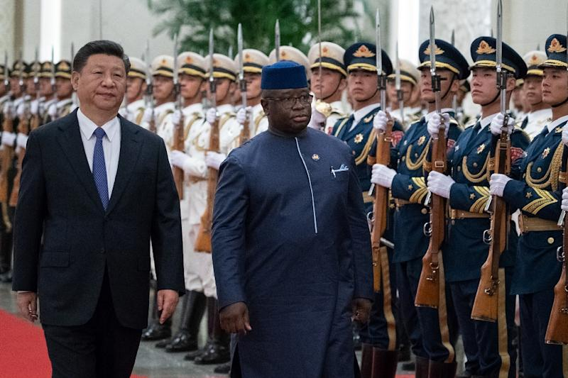 Sierra Leone President Julius Maada Bio, seen reviewing the Chinese People's Liberation Army honour guard with President Xi Jinping in Beijing, is one of a host of African leaders to attend the the Forum on China-Africa Cooperation (AFP Photo/Roman PILIPEY)
