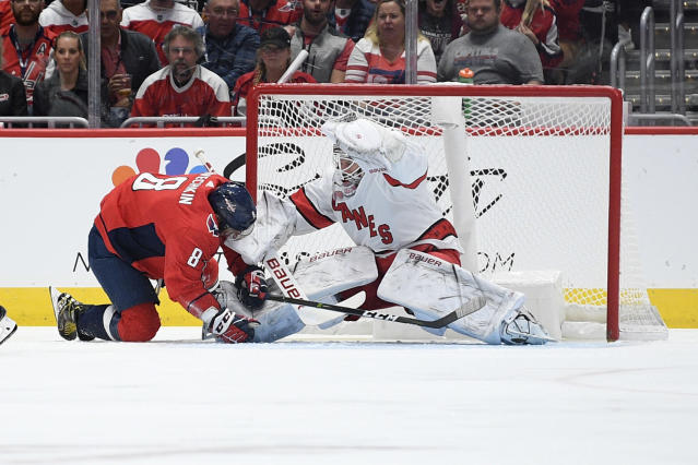 Washington Capitals left wing Alex Ovechkin, left,, of Russia, collides with Carolina Hurricanes goaltender James Reimer (47) during the first period of an NHL hockey game, Saturday, Oct. 5, 2019, in Washington. (AP Photo/Nick Wass)