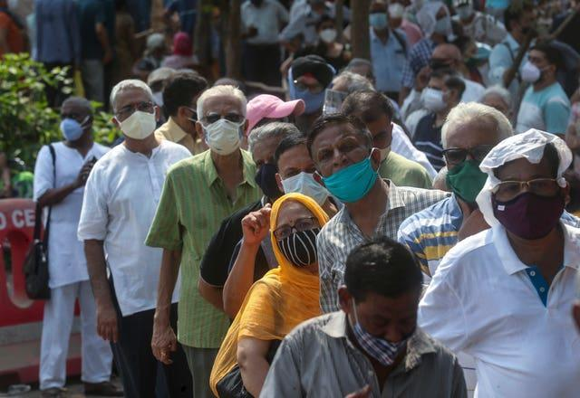 People queue for a Covid-19 vaccine in Mumbai, India