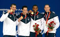 <p>(L-R) Michael Phelps, Garrett Weber-Gale, Cullen Jones, and Jason Lezak of the United States pose with the gold medal during the medal ceremony for the Men's 4 x 100-meter freestyle relay on August 11, 2008 in Beijing, China. The United States finished the race in first place in a time of 3:08.24, winning the gold medal and set a new World Record. (Mike Hewitt/Getty Images)</p>