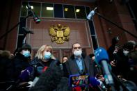 Olga Mikhailova and Vadim Kobzev, lawyers of Russian opposition leader Alexei Navalny, speak to the media after a court hearing, outside Moscow