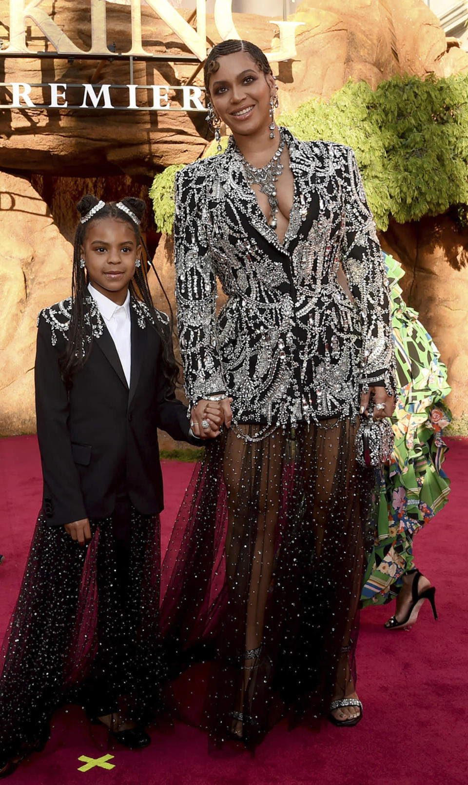 """FILE - In this July 9, 2019 file photo, Beyonce, right, and her daughter Blue Ivy Carter arrive at the world premiere of """"The Lion King"""" at the Dolby Theatre in Los Angeles. At just 7, Blue Ivy Carter is an award-winning songwriter. Jay-Z and Beyoncé's daughter won the Ashford & Simpson Songwriter's Award at the Soul Train Awards on Sunday, Nov. 17 for co-writing her mom's hit """"Brown Skin Girl,"""" a song celebrating dark- and brown-skinned women. Ivy gives a vocal performance that opens and closes the song, which also features Wizkid and Saint Jhn. (Photo by Chris Pizzello/Invision/AP, File)"""