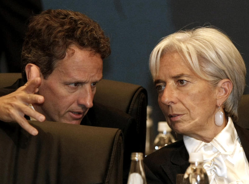 U.S. Treasury Secretary Timothy Geithner, left, talks with France's Finance Minister Christine Lagarde during  the G20 Finance Ministers and Central Bank Governors meeting in Gyeongju, South Korea, Friday, Oct. 22, 2010.(AP Photo/Ahn Young-joon, Pool)