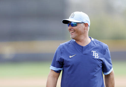 Tampa Bay Rays manager Kevin Cash takes the practice field during the start of baseball spring training in Port Charlotte, Fla., Thursday, Feb. 13, 2020. (Octavio Jones/Tampa Bay Times via AP)