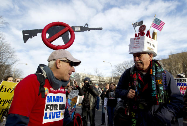<p>Steven Rothman, left, and Dan Knorowski attend the March for Our Lives rally in Washington in support of stricter gun control. (Photo: AP/Jose Luis Magana) </p>