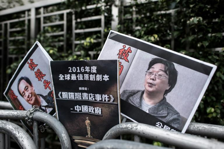 Placards at a demonstration in Hong Kong in 2016 show incarcerated bookseller Gui Minhai (right) and his associate Lee Bo