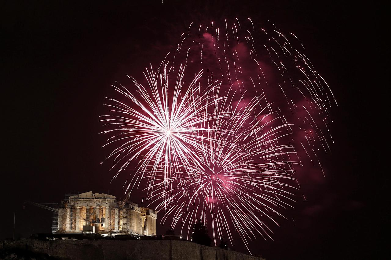 Fireworks explode over the temple of the Parthenon during New Year celebrations in Athens, Greece January 1, 2013.