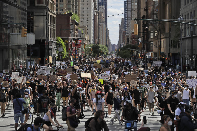 New York City lifted the curfew spurred by protests in the wake of George Floyd's death. Pictured are protesters in Manhattan.