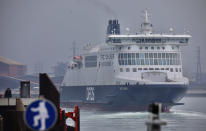 A cross-channel ferry leaves the Port of Dunkerque, France, Friday Aug.14, 2020. British holiday makers in France were mulling whether to return home early Friday to avoid having to self-isolate for 14 days following the U.K. government's decision to reimpose quarantine restrictions on France amid a recent pick-up in coronavirus infections. (AP Photo/Olivier Matthys)