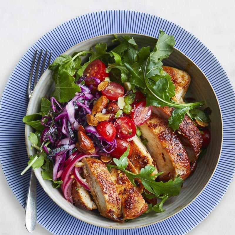"""<p>A medley of spices — paprika, cumin, and cinnamon — gives this chicken an extra kick.</p><p><a href=""""https://www.womansday.com/food-recipes/food-drinks/recipes/a61042/moroccan-chicken-bowl-recipe/"""" rel=""""nofollow noopener"""" target=""""_blank"""" data-ylk=""""slk:Get the recipe for Moroccan Chicken Bowl."""" class=""""link rapid-noclick-resp""""><u><u><em>Get the recipe for Moroccan Chicken Bowl.</em></u></u></a></p>"""