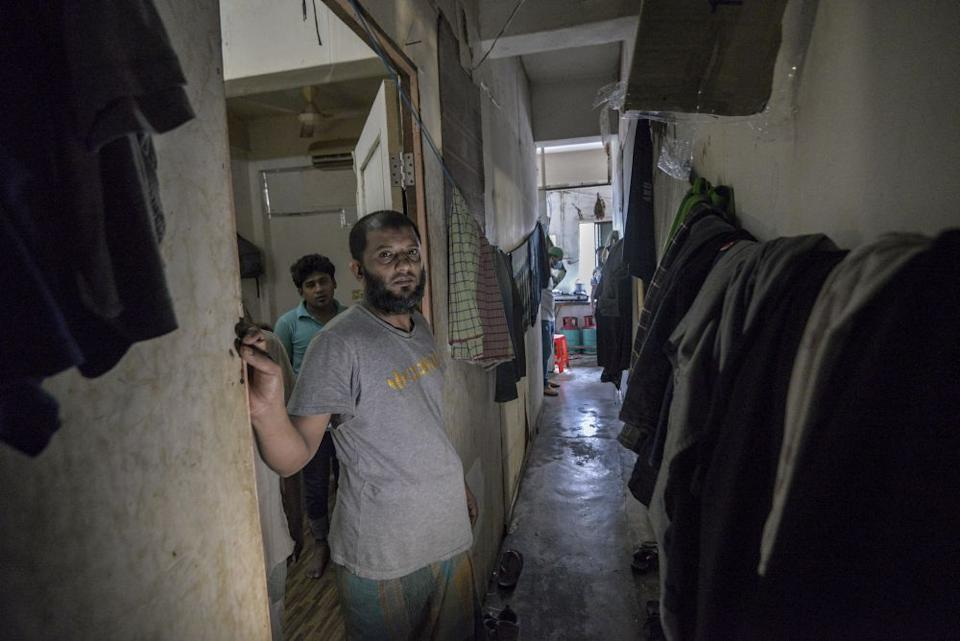 The narrow corridor in the apartment where nine Bangladeshis live. — Picture by Shafwan Zaidon