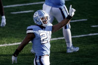 North Carolina linebacker Chazz Surratt (21) reacts following a sack against Wake Forest during the second half of an NCAA college football game in Chapel Hill, N.C., Saturday, Nov. 14, 2020. (AP Photo/Gerry Broome)