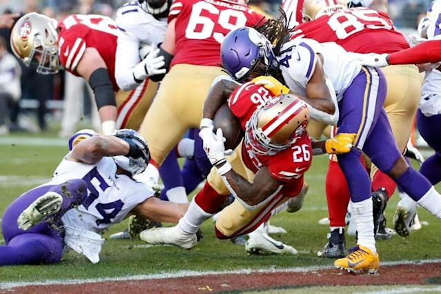 Tevin Coleman rumbles over for his second touchdown in San Francisco's victory over Minnesota (AFP Photo/Lachlan Cunningham)