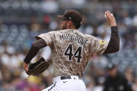 San Diego Padres starting pitcher Joe Musgrove winds up in the first inning of a baseball game against the Atlanta Braves, Sunday, Sept. 26, 2021, in San Diego. (AP Photo/Derrick Tuskan)
